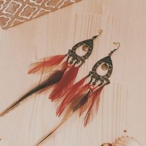 Boucles d'oreilles orientales bronze plumes de coq filant